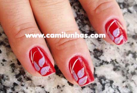 Unha decorada de vermelho com gliter